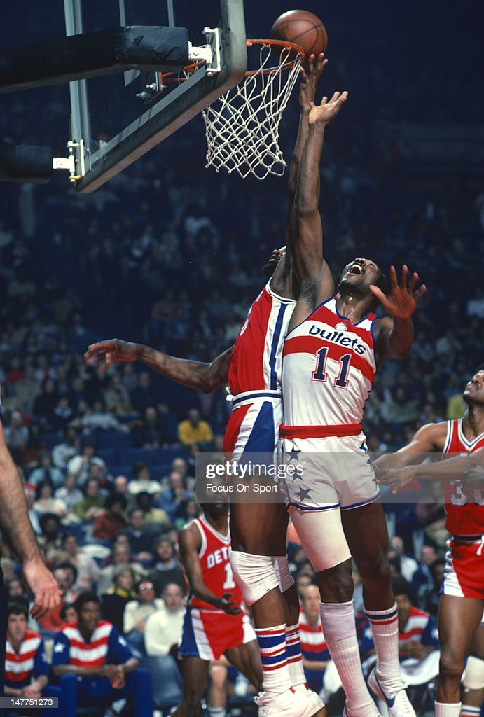 Bob Lanier of the Detroit Pistons battles for a rebound with Elvin Hayes of the Washington Bullets during an NBA basketball game circa 1977 at the...