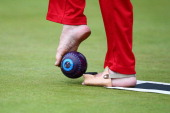 Bob Love of England prepares to bowl in the bronze medal ParaSport Open Triples B6/B7/B8 lawn bowls match between England and Scotland at Kelvingrove...