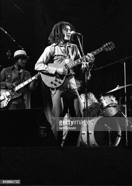 Bob Marley and Aston 'Family Man' Barrett of The Wailers perform on stage at the Odeon Birmingham United Kingdom 18 July 1975