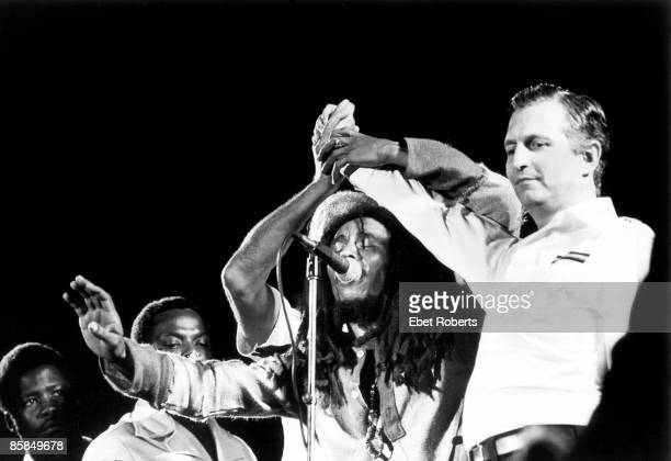 Photo of Bob MARLEY Bob Marley on stage with Prime Minister Michael Manley opposition leader Edward Seaga at the One love peace concert