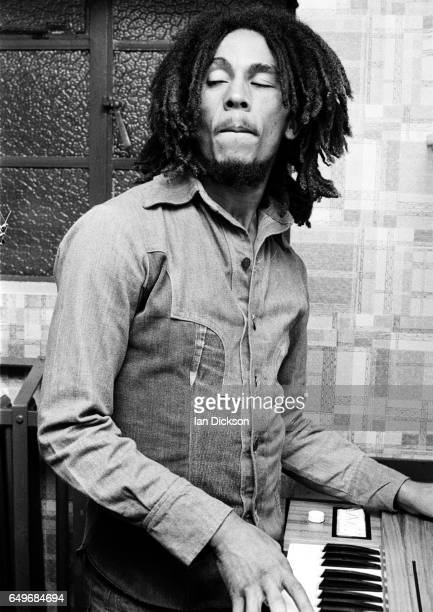 Bob Marley of The Wailers playing keyboard backstage at the Odeon Birmingham United Kingdom 18 July 1975