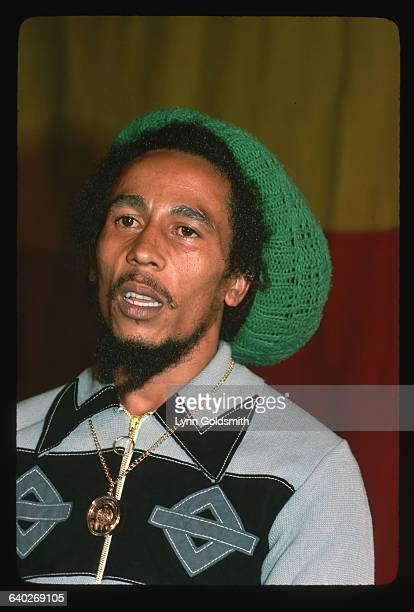 Bob Marley wears a green knit hat