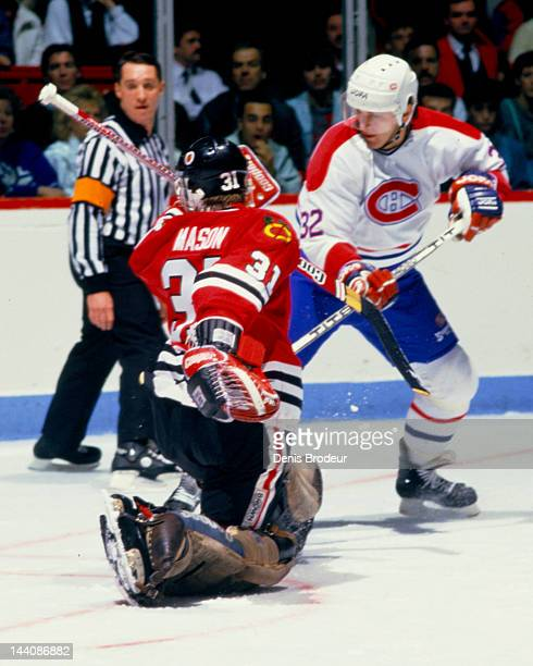 Bob Mason of the Chicago Blackhawks saves a shot by Claude Lemieux of the Montreal Canadiens Circa 1987 at the Montreal Forum in Montreal Quebec...