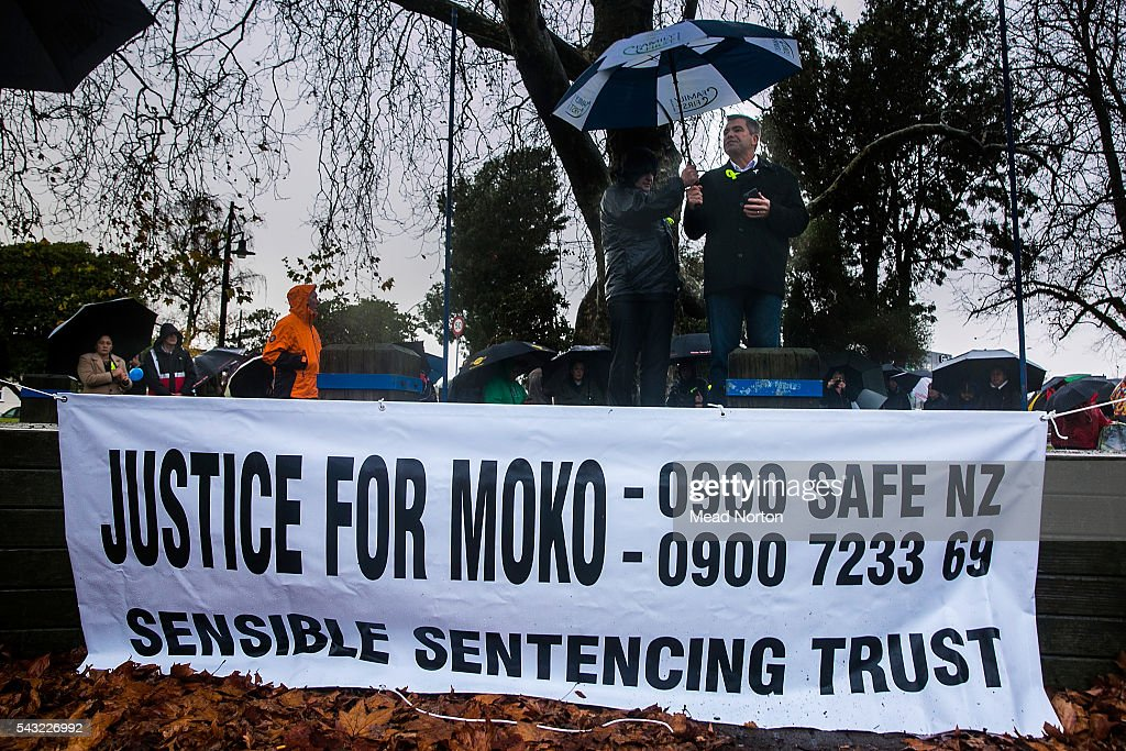 Bob McCoskrie speaks to the crowd gathered in the rain protesting the lack of justice in the NZ courts for victims of child abuse on June 27, 2016 in Rotorua, New Zealand. Three year old toddler Moko Rangitoheriri died on August 10, 2015 from injuries he received during prolonged abuse and torture at the hands of his carers. His killers Tania Shailer and David Haerewa were sentenced at Rotorua High Court today.
