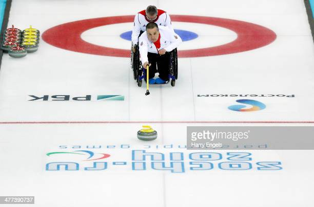 Bob McPherson of Great Britain competes in the wheelchair curling mixed round robin match between Great Britain and Sweden at the Ice Cube Curling...