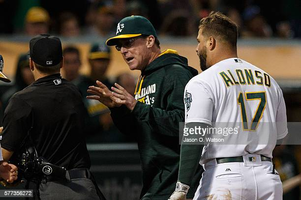 Bob Melvin of the Oakland Athletics and Yonder Alonso are ejected by umpire Mark Wegner after arguing a called third strike during the fourth inning...