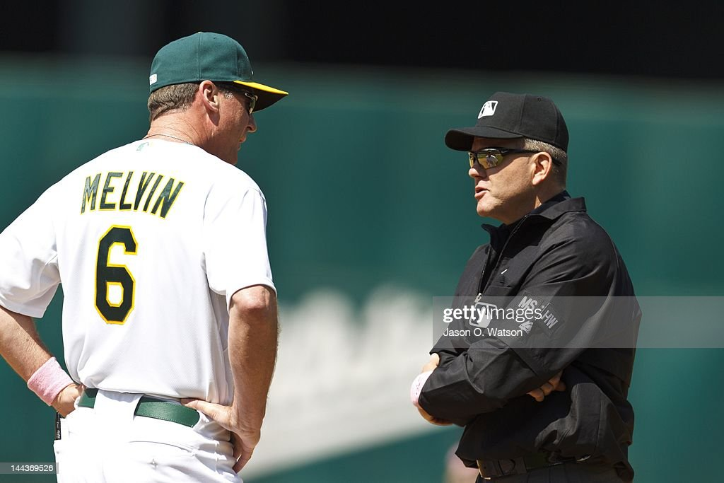 <a gi-track='captionPersonalityLinkClicked' href=/galleries/search?phrase=Bob+Melvin&family=editorial&specificpeople=239192 ng-click='$event.stopPropagation()'>Bob Melvin</a> #6 of the Oakland Athletics argues a call with first base umpire <a gi-track='captionPersonalityLinkClicked' href=/galleries/search?phrase=Mike+Everitt&family=editorial&specificpeople=238854 ng-click='$event.stopPropagation()'>Mike Everitt</a> #57 (right) during the sixth inning against the Detroit Tigers at O.co Coliseum on May 13, 2012 in Oakland, California. The Detroit Tigers defeated the Oakland Athletics 3-1.