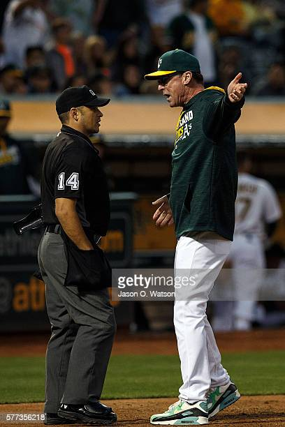 Bob Melvin of the Oakland Athletics argues with umpire Mark Wegner after being ejected for arguing a called third strike during the fourth inning...