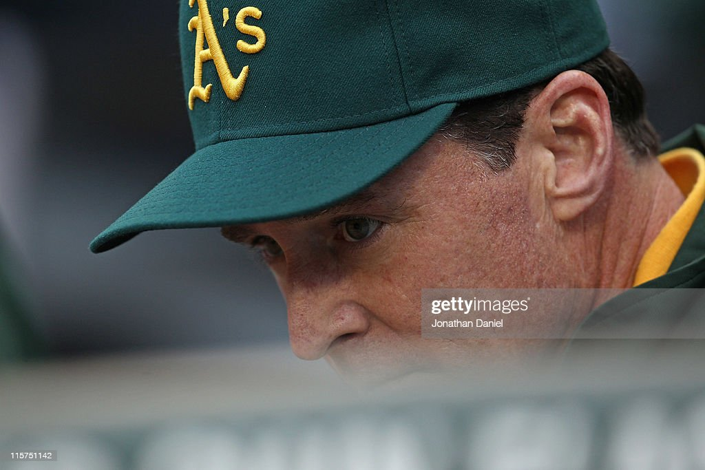 <a gi-track='captionPersonalityLinkClicked' href=/galleries/search?phrase=Bob+Melvin&family=editorial&specificpeople=239192 ng-click='$event.stopPropagation()'>Bob Melvin</a> #6, today named interim manager of the Oakland Athletics, waits in the dugout for a game against the Chicago White Sox at U.S. Cellular Field on June 9, 2011 in Chicago, Illinois.