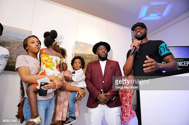 Bob Metelus and Dwyane Wade attend Haitian photographer Bob Metelus unveils newest collection Haiti A Collective Cry from a Forgotten Paradise on...