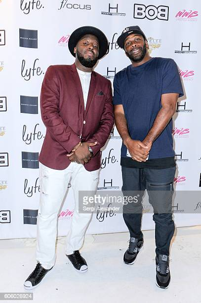 Bob Metelus and Earl Little attend Haitian photographer Bob Metelus unveils newest collection Haiti A Collective Cry from a Forgotten Paradise on...