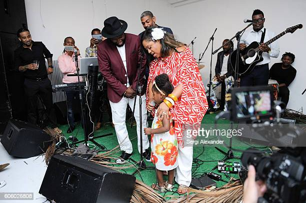 Bob Metelus and Lisa Metelus onstage at Haitian photographer Bob Metelus unveils newest collection Haiti A Collective Cry from a Forgotten Paradise...