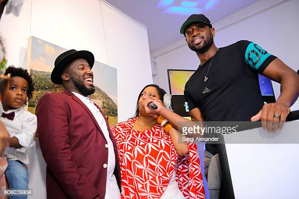 Bob Metelus Lisa Metelus and Dwyane Wade attend Haitian photographer Bob Metelus unveils newest collection Haiti A Collective Cry from a Forgotten...