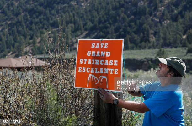 Bob Morgan hangs a monument support sign at his house in the Grand StaircaseEscalante National Monument on May 11 2017 outside Escalante Utah The...