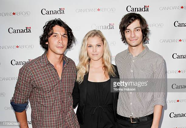 Bob Morley Eliza Tyler and Devon Bostick attend the 2013 Canada Day in LA party at Wokano restaurant on June 30 2013 in Santa Monica California