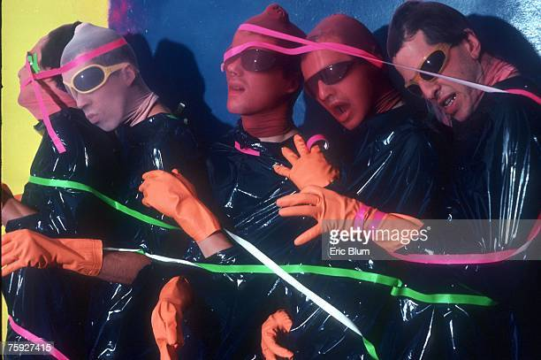 Bob Mothersbaugh Mark Mothersbaugh Alan Myers Gerald Casale and Bob Casale of the punk new wave music group 'Devo' pose for a portrait covered in...