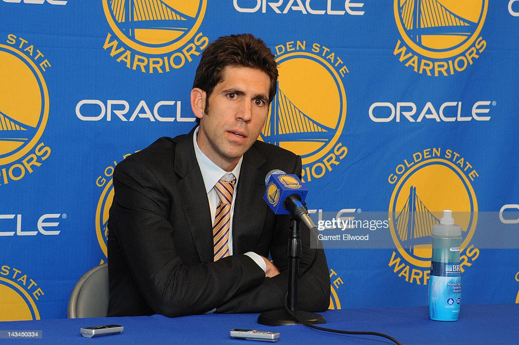 Bob Myers, the new general manager of the Golden State Warriors, speaks to members of the media before a game against the San Antonio Spurs on April 26, 2012 at Oracle Arena in Oakland, California.