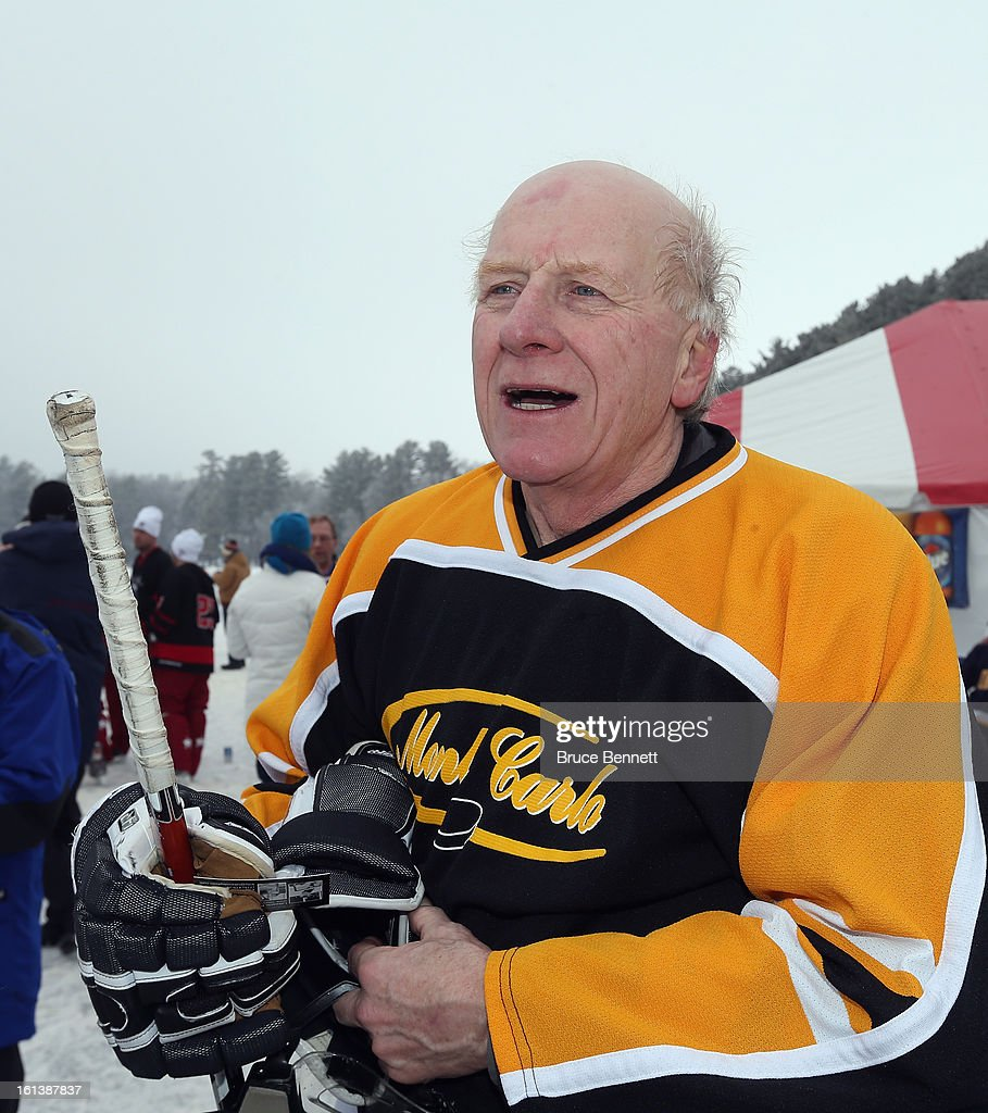 Bob Perrault of the River Valley Monte Carlo team celebrates victory in the 60+ division in the 2013 USA Hockey Pond Hockey National Championships on February 10, 2013 in Eagle River, Wisconsin. The three day tournament features 2,400 participants from 30 states playing a round robin tournament on 28 rinks laid out on Dollar Lake.