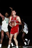 Bob Petit of the St Louis Hawks looks to score against Bill Russell of the Boston Celtics during a 1960s NBA game at the Boston Garden in Boston...