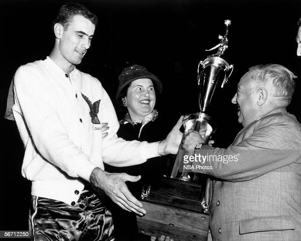 Bob Pettit of the Eastern Conference AllStars is awarded the AllStar MVP Trophy after the 1956 NBA AllStar Game in Rochester New York NOTE TO USER...