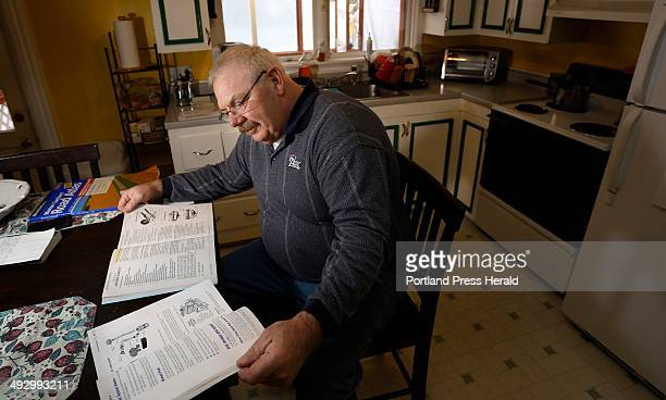 Bob Prescott who was laid off by Hostess late last year studies in kitchen of his Portland home Friday January 25 for his upcoming CDL drivers' test