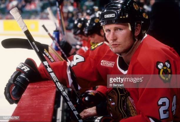 Bob Probert of the Chicago Blackhawks sits on the bench during an NHL game circa February 2000