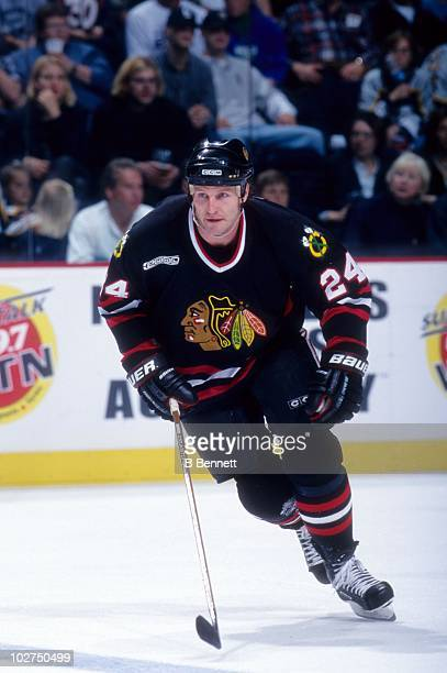 Bob Probert of the Chicago Blackhawks skates on the ice during an NHL game circa 2000
