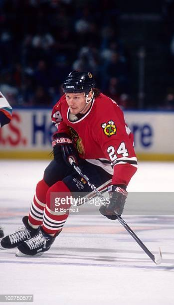 Bob Probert of the Chicago Blackhawks skates on the ice during an NHL game against the New York Islanders circa 1997 at the Nassau Coliseum in...