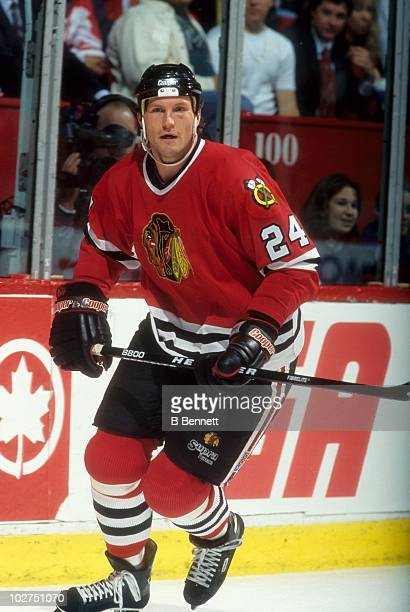 Bob Probert of the Chicago Blackhawks skates on the ice during an NHL game circa 1997