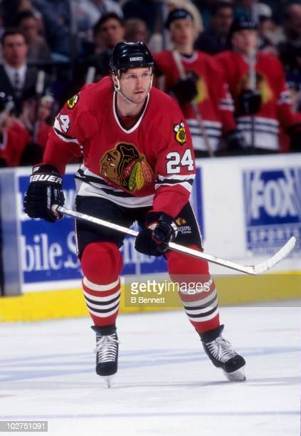 Bob Probert of the Chicago Blackhawks skates on the ice during an NHL game circa April 1997