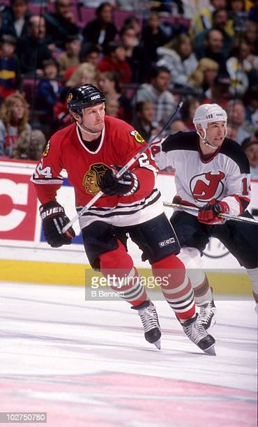 Bob Probert of the Chicago Blackhawks skates up the ice as Brian Rolston of the New Jersey Devils tries to stay with him during their game on March...