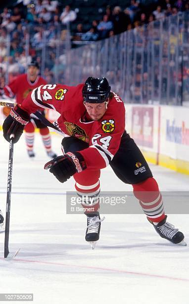 Bob Probert of the Chicago Blackhawks skates up the ice during an NHL game circa September 1996