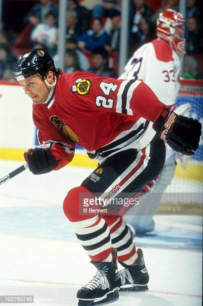 Bob Probert of the Chicago Blackhawks skates up the ice during an NHL game against the Montreal Canadiens on October 28 1995 at the Montreal Forum in...