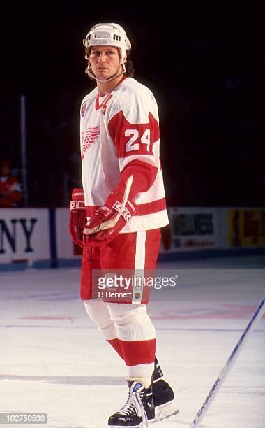 Bob Probert of the Detroit Red Wings looks on during an NHL game circa 1993 at the Joe Louis Arena in Detroit Michigan