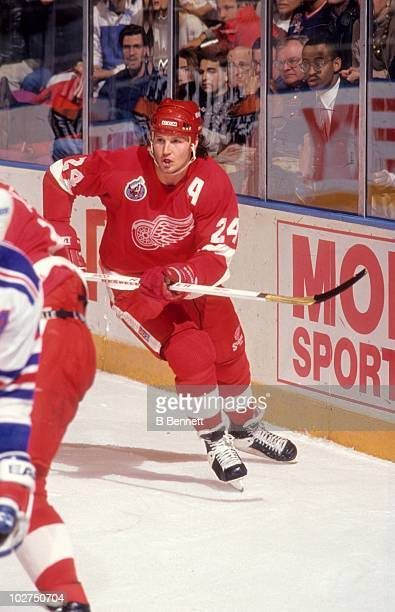 Bob Probert of the Detroit Red Wings skates around the net during an NHL game against the New York Rangers on December 2 1992 at the Madison Square...