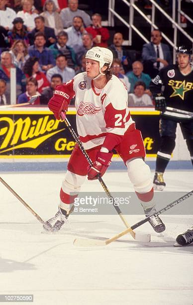 Bob Probert of the Detroit Red Wings waits for the play during an NHL game against the Minnesota North Stars circa 1993 at the Joe Louis Arena in...