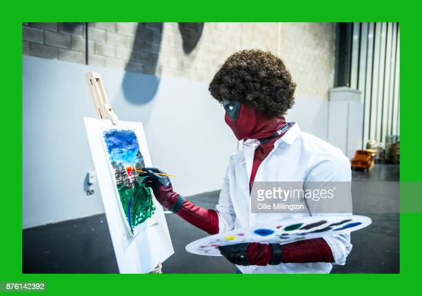 Bob Ross Deadpool cosplayer painting in character during the Birmingham MCM Comic Con held at NEC Arena on November 18 2017 in Birmingham England
