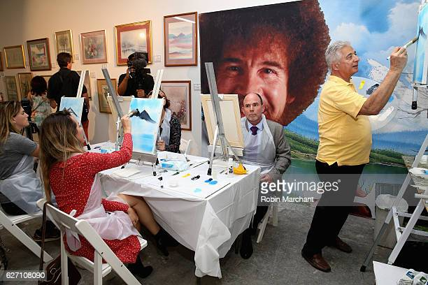 Bob Ross instructor Bernie Oropollo with guests at When The Art Comes Down Works From The Super 8 Collection Miami Edition a celebration of Super 8's...