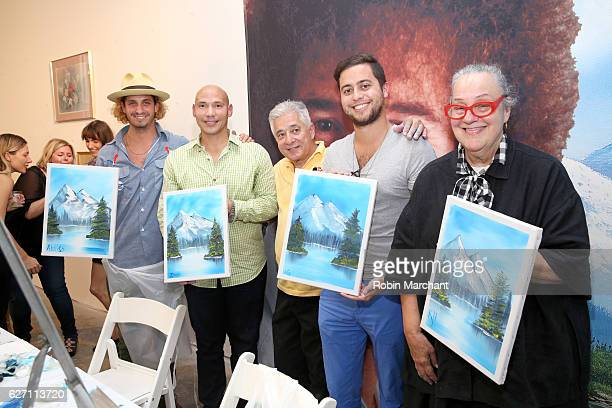 Bob Ross Instructor Bernie Oropollo with guests at When The Art Comes Down Miami Beach hosted by Super 8 on December 1 2016 in Miami Florida