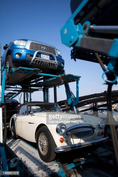 Bob Russell's 1967 AustinHealey waits to be moved from a large car carrier to a small trailer to make its final leg of the trip from California to...