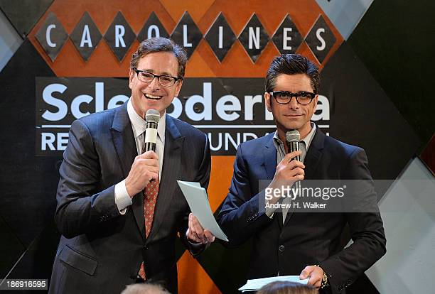 Bob Saget and John Stamos attend an evening of top chefs and headlining comedians to help cure Scleroderma at Carolines on November 4 2013 in New...