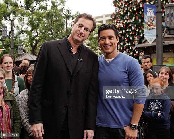 Bob Saget and Mario Lopez attend Extra at The Grove on November 19 2010 in Los Angeles California