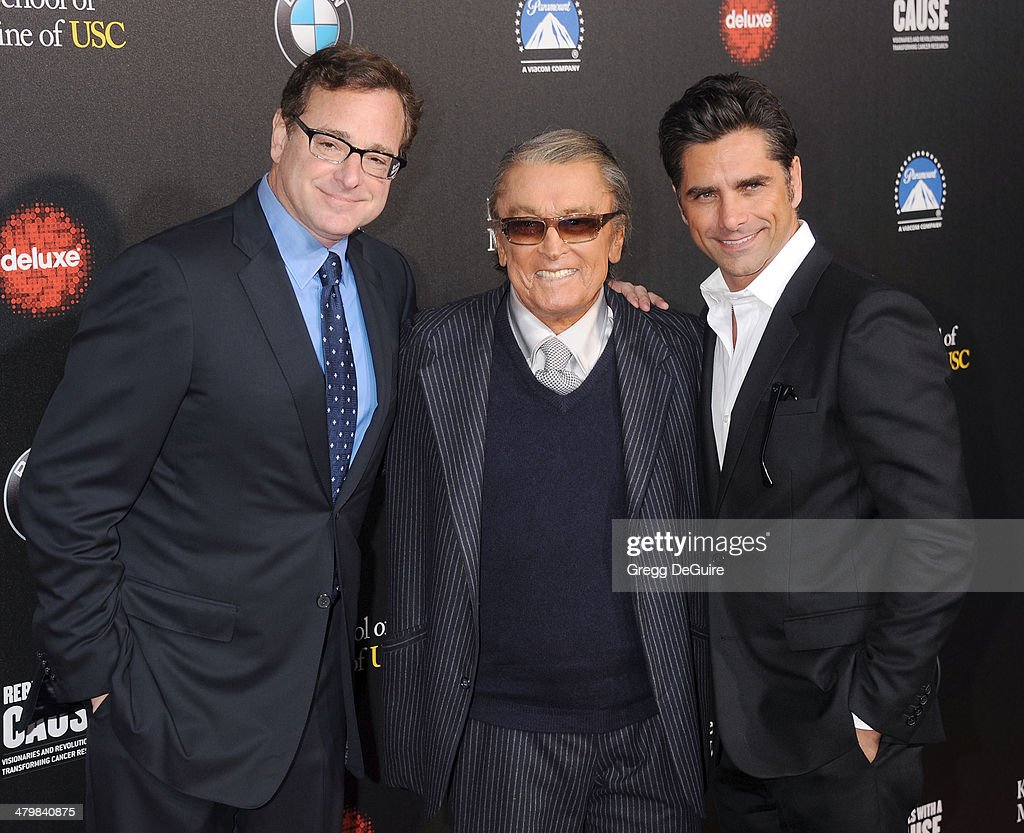 Bob Saget Robert Evans and John Stamos arrive at the 2nd Annual Rebel With A Cause Gala at Paramount Studios on March 20 2014 in Hollywood California