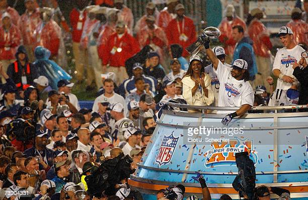 Bob Sanders of the Indianapolis Colts celebrates with the Vince Lombardi Trophy next to head coach Tony Dungy and his wife Lauren Dungy after the...