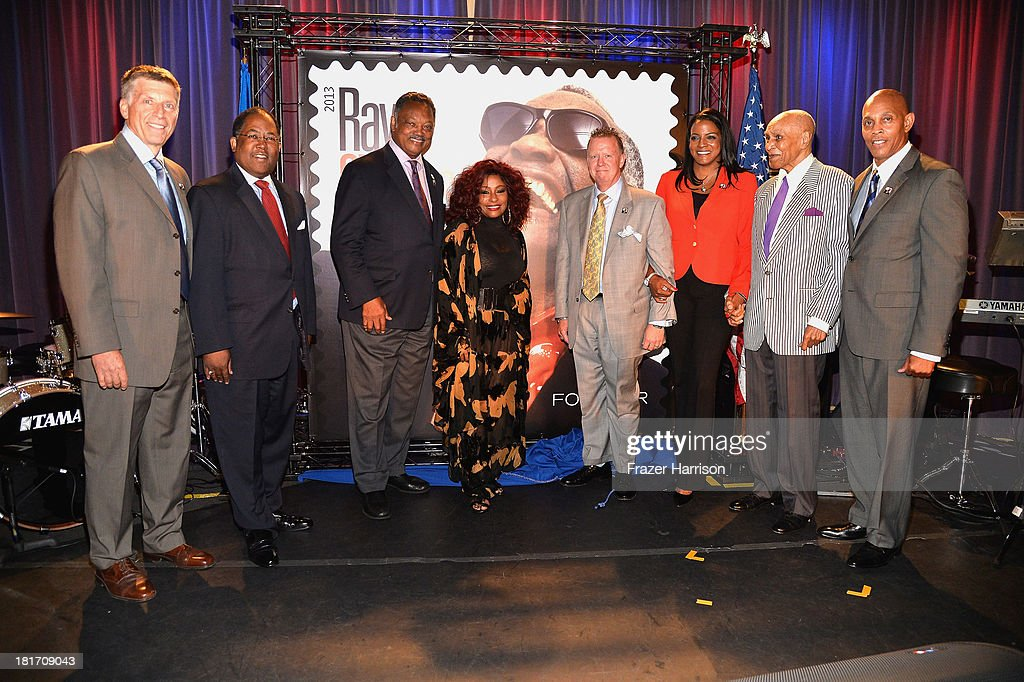 Bob Santelli, Executive Director of the GRAMMY Museum, Mark Ridley-Thomas, Chairman of the Los Angeles County Board of Supervisors; Reverend Jesse Jackson; singer Chaka Khan, Ten-time GRAMMY Award-winning performer; Cliff Rucker, U.S. Postal Service Vice President of Sales; Valerie Ervin, Executive Director of the Ray Charles Foundation; Joe Adams, Ray Charles' former manager, Raye Charles Robinson, Jr., Ray Charles' son attend the unveiling of the new Ray Charles stamp at the GRAMMY Museum in Los Angeles, Calif, on Monday, September 23, 2013. The limited-edition stamp is part of the Music Icons stamp series and is available for sale starting today, on what would have been his 83rd birthday, at post offices nationwide