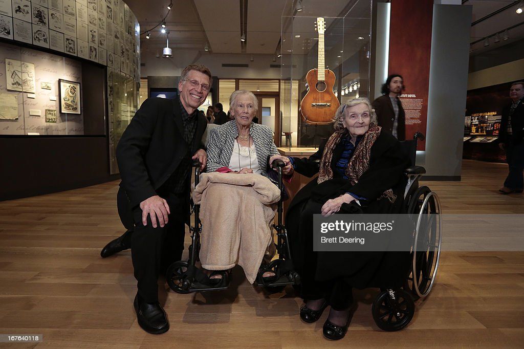Bob Santelli, executive director of the Grammy Museum, Mary Boyle, Woody Guthrie's first wife and and Mary Jo Edgmon, Woody Guthrie's sister pose for photos at the Woody Guthrie Center on April 26, 2013 in Tulsa, Oklahoma.