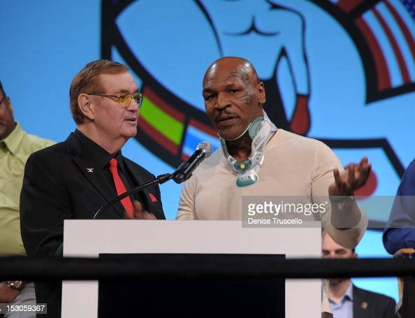 Bob Sheridan and boxing champion Larry Holmes and George Foreman during a press conference at Bellagio Las Vegas on September 29 2012 in Las Vegas...