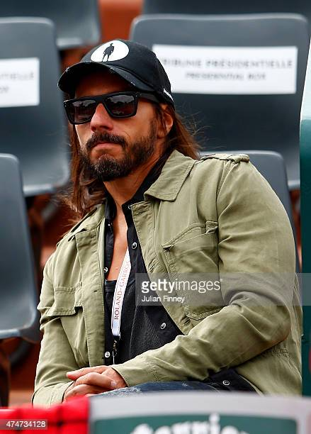 Bob Sinclair looks on on day two of the 2015 French Open at Roland Garros on May 25 2015 in Paris France