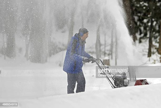 Bob Stevens pushes his snow blower up his driveway along Princeton Drive in State College Pa A winter storm hit Centre County Wednesday February 5...