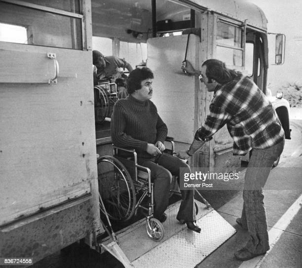 Bob Stewart Denver public school bus driver operates a lift for Gonzales who is on his way to a parttime job at Denver Social Security office Credit...